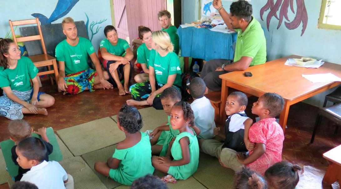 Two volunteers lead a creative class for the local children during their Teaching project in Fiji